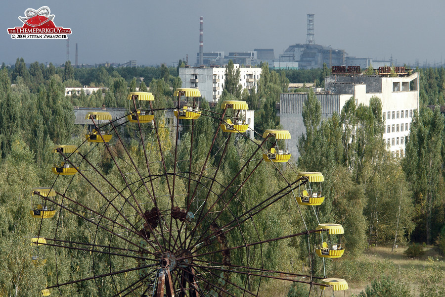 Abandoned fairground, with Chernobyl power plant in the background