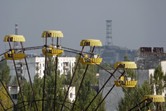 Up close: Pripyat ferris wheel with Chernobyl power plant