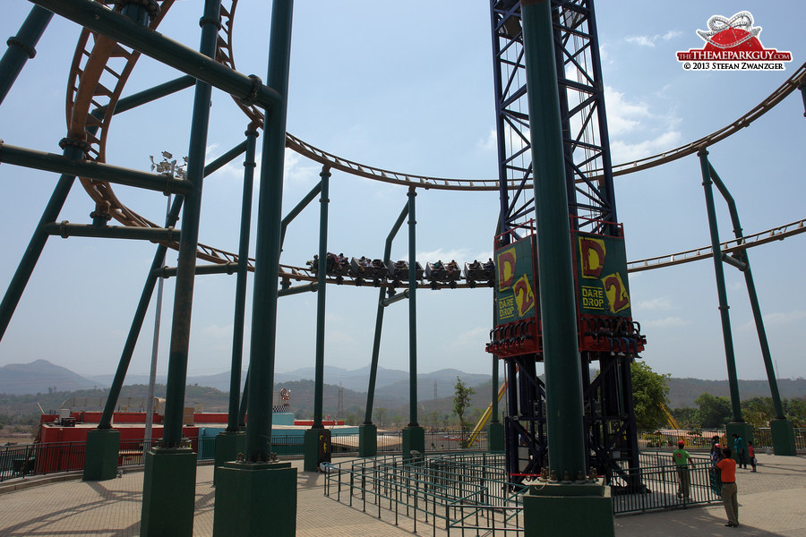 Coaster circling circles around drop tower