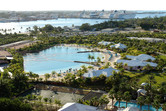 Dolphin lagoon with ocean liners in the background