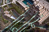 Coaster-shaped slides protruding from the tower