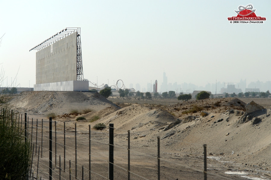 Billboard, sales center coaster and rocket against the backdrop of Dubai skyline