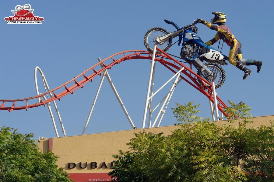 Giant biker on giant coaster track