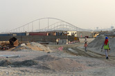 Yas Island workers in the foreground, Formula Rossa in the background