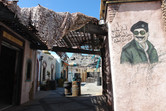 Saddam Hussein on bright walls