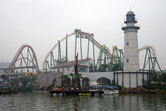 Lighthouse and coaster in the smog