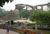 Overgrown water slides with cleaning staff