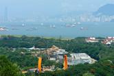 Hong Kong Disneyland, with both Kowloon and Hong Kong in the background