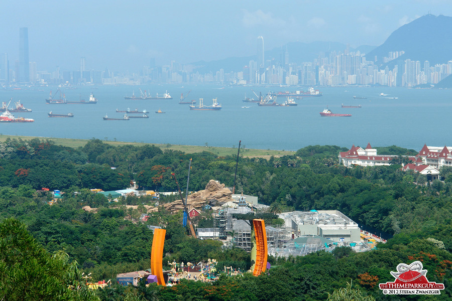 Hong Kong Disneyland, with both Kowloon and Hong Kong in the background