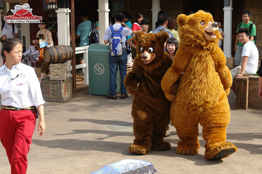 Why does the cast member on the left look so protective?
