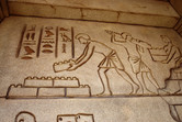 Engravings on the walls of an Egyptian-themed dark ride