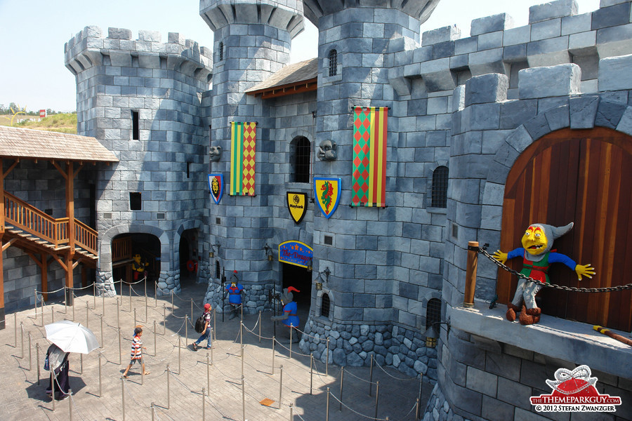 Good heavens, guests! This castle serves as The Dragon coaster loading station.