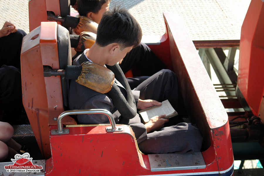 This guy is reading a book on the ride