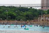 Giant suspension bridge over giant pool