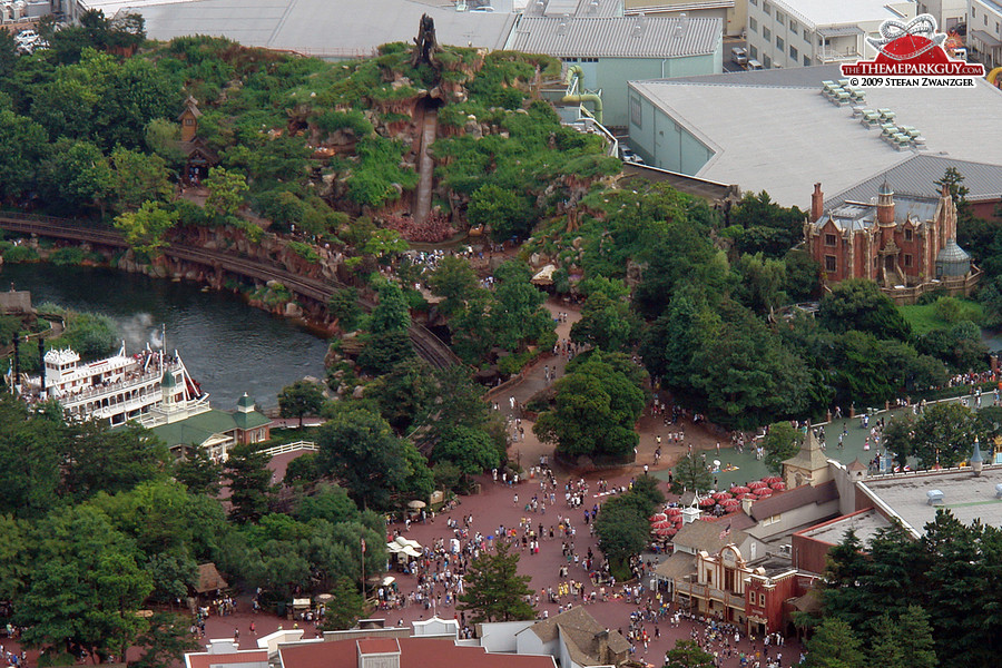 Splash Mountain flume ride on the left, Haunted Mansion ghost train on the right