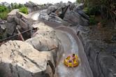 Tube slides through rocky scenery