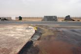 Flat, barren desert behind