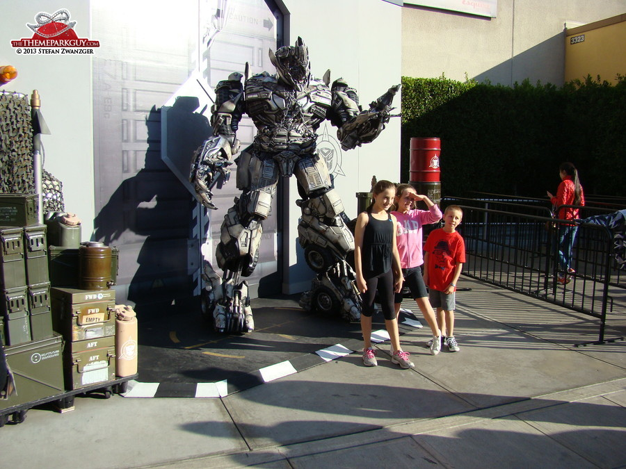 Transformers character posing with the kids