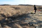 Technician surveying the dinosaur site