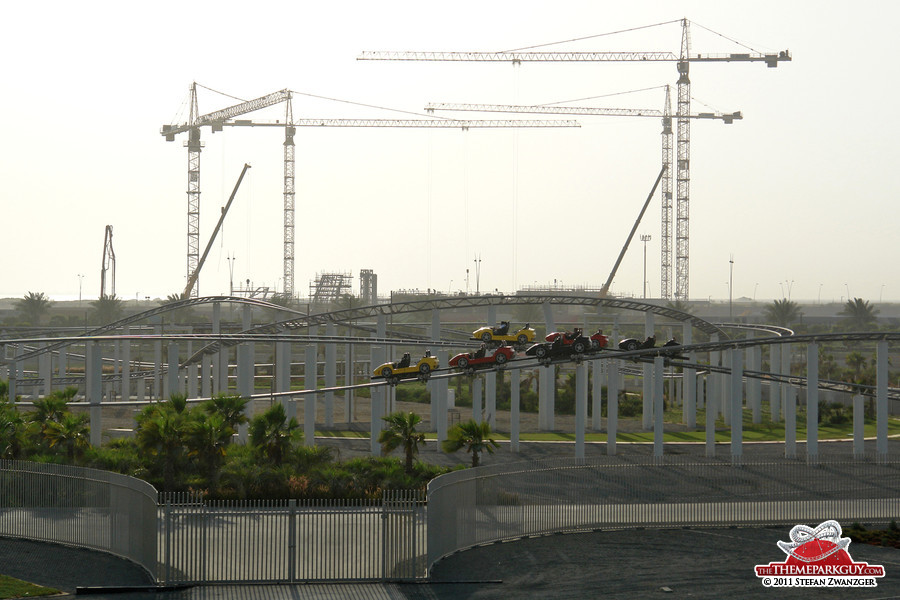 Ferrari World dueling coaster at the front, water park cranes at the back