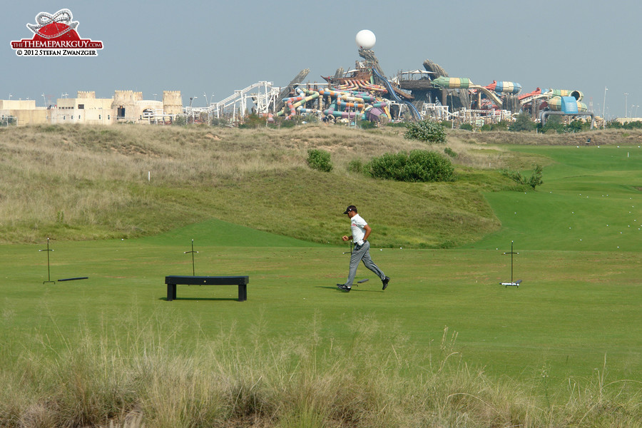 Yas Island golf course with Yas Waterworld backdrop