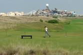 Yas Island golf course with Yas Waterworld backdrop