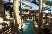 Lazy river meandering through slide jungle