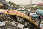 Freshly crafted rockwork among the slides, with Ferrari World in the background